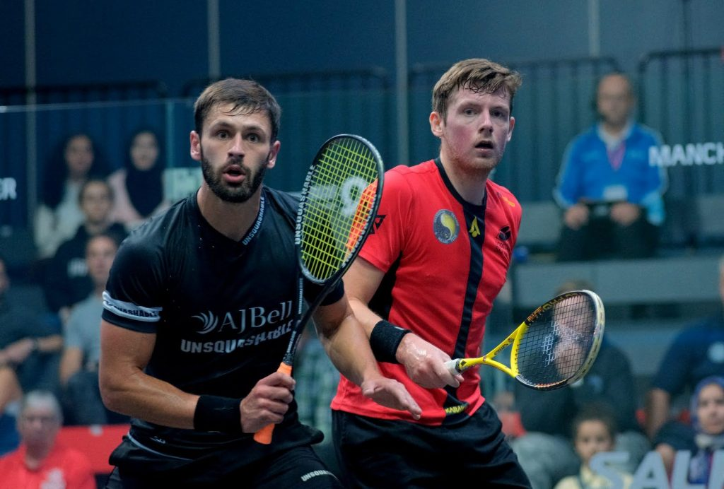 George Parker (left) takes on Greg Lobban (right)